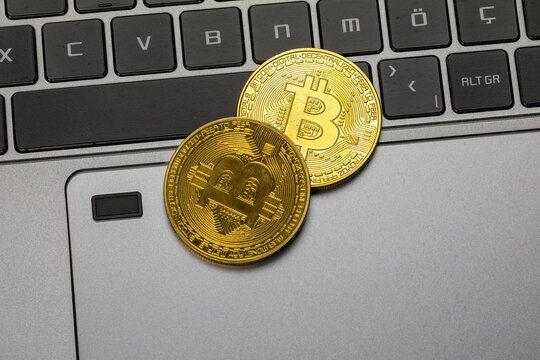 Bitcoin gold coin. Cryptocurrency and laptop
