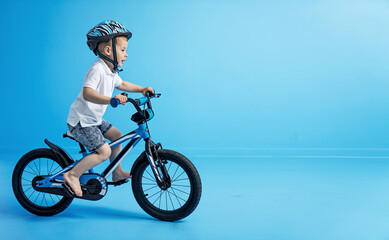Picture of little boy riding a bike - riding lesson