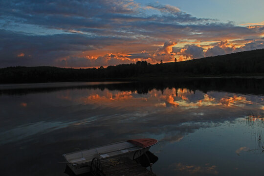 dramatic sunset over a calm lake