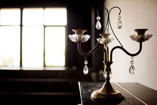 metal vintage candlestick on a blurred background.