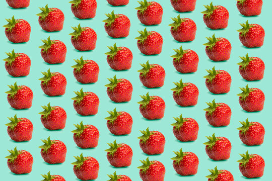 Strawberies on the mint green background, creative layout, fresh fruit concept, strawbery with leaves