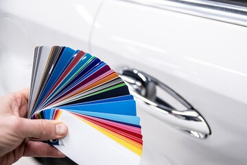 Obraz Man choosing color of his car with color sampler. Car foil wrapping colors picker - fototapety do salonu