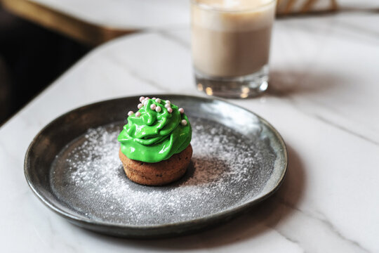 St. Patrick's Day cupcake on a dark plate on the table