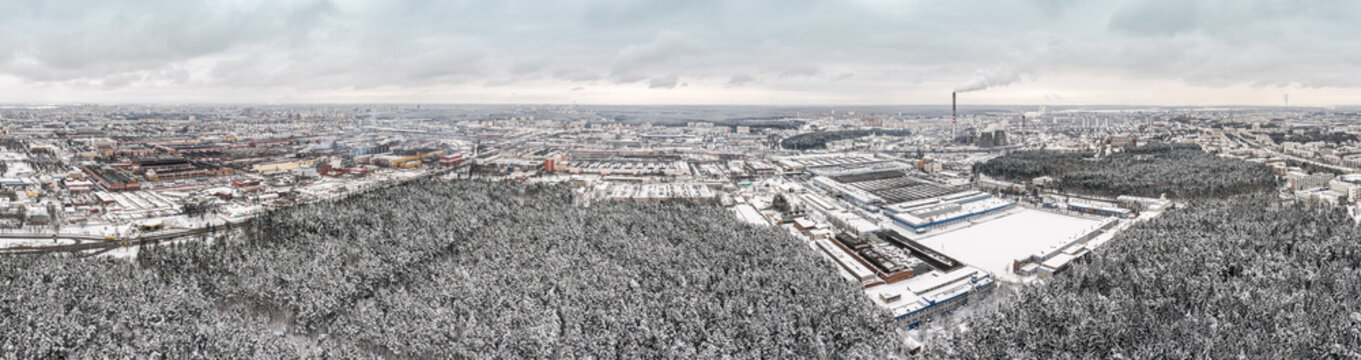 panoramic aerial view of urban industrial district with factory buildings, warehouses and thermal power plant with smokestacks. Minsk, Belarus.