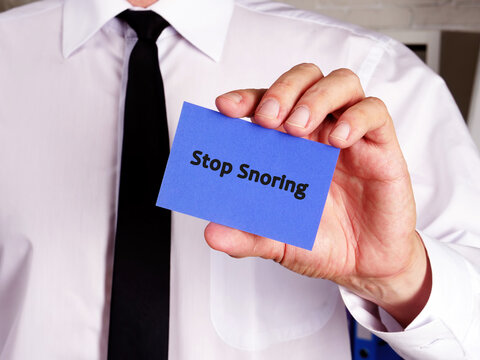 Business concept about Stop Snoring with phrase on the piece of paper.