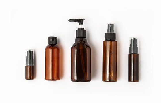 Amber glass cosmetic bottles on white background. Blank label for branding mock-up.