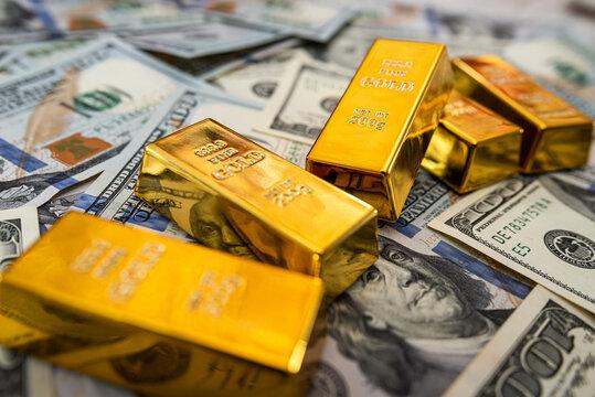 saving concept dollar bills and gold bar