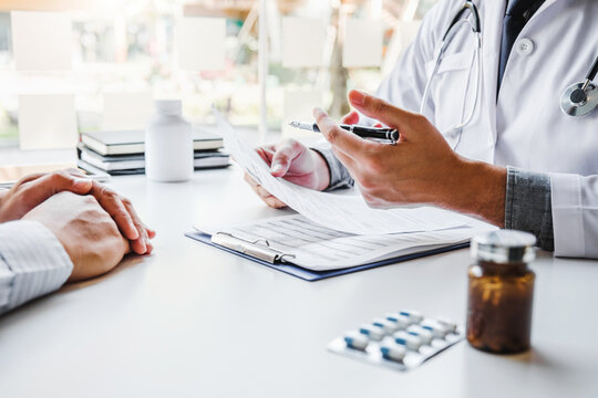 Doctor or physician recommend pills medical prescription to male Patient