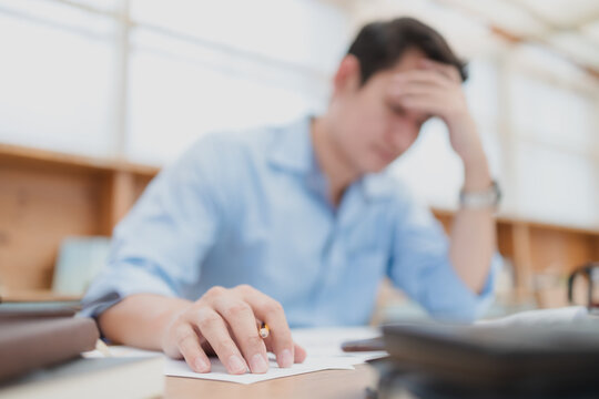 Tired businessman hold pencil at workplace in office and headache or angry. Overworking, making mistake, stress, termination, fail, bad, sad tired or depression concept