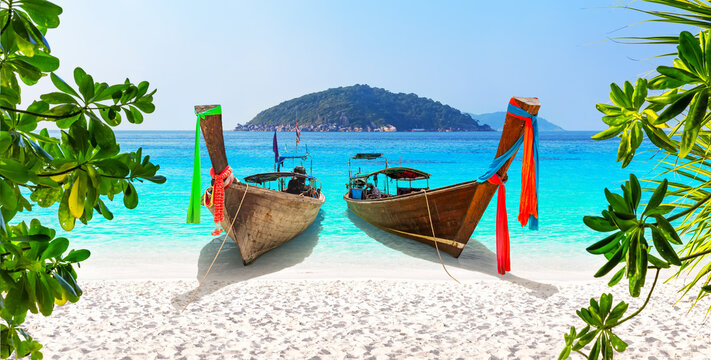 Beautiful beach with thai traditional wooden longtail boat and blue sky in Similan islands, Thailand.