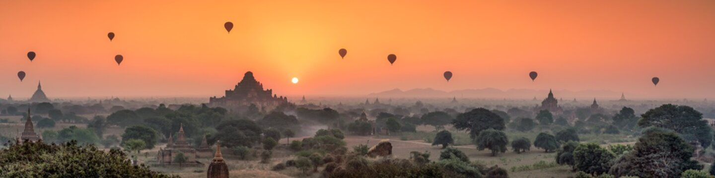 Aerial view of Dhammayangyi temple and hot air balloons at sunrise, Bagan, Myanmar