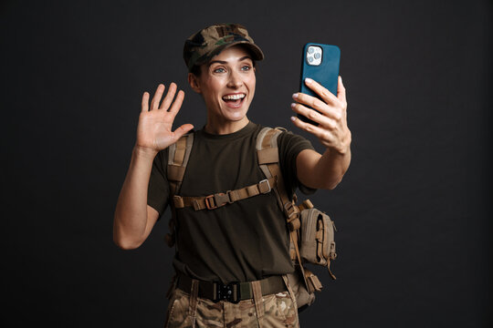Happy young military woman on a video call