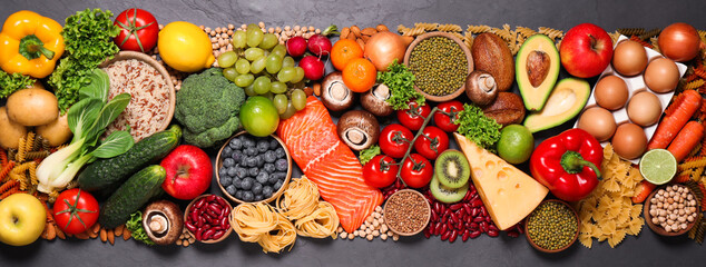 Different products on black table, top view. Healthy food and balanced diet