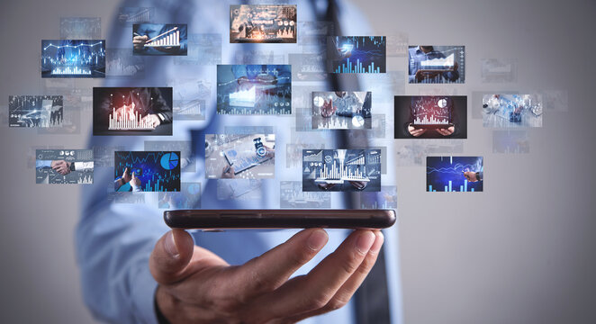 Man holding a digital pictures of business graphs. Business. Technology