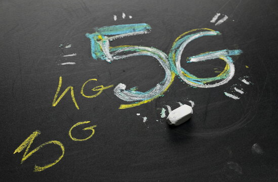 5G wireless network symbol, wifi internet signs drawn on black chalkboard with colorful chalk, blackboard background and texture