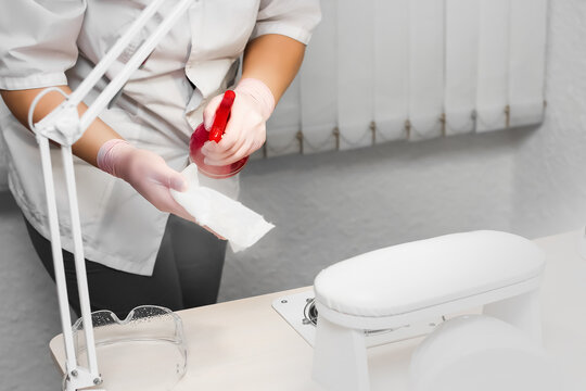 Disinfection of surfaces from viruses and bacteria. Treatment of the table and tools before the procedure in the manicure and pedicure salon. Sterility and cleanliness.