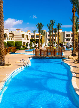 Sharm El Sheikh, Egypt - 02 april 2019: Hotels large clean swimming pool with interesting wooden bridges