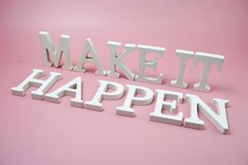 Make It Happen word alphabet letters on pink background
