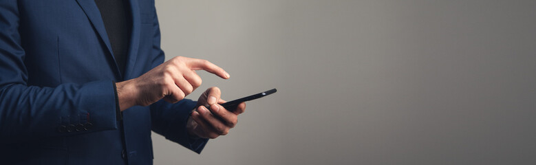 Fototapeta business man holding smart phone obraz