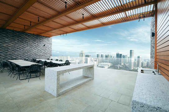 Modern sky lounge  and kitchen on roof top and stunning cityscape view. 3D rendering
