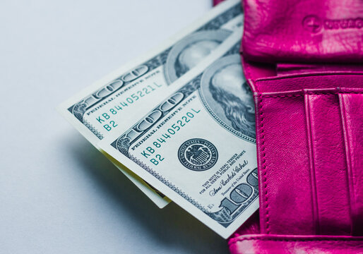 Money in the amount of two hundred dollars in a pink women's wallet