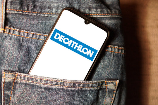 LEIPZIG, GERMANY - Jan 21, 2021: Logo of decathlon on a smartphone display in a jeans pocket