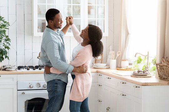 Romantic African American Couple Dancing In Kitchen Interior