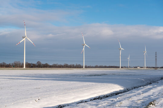 Wind farm for electric power production. Winter landscape in northern Poland. Europe