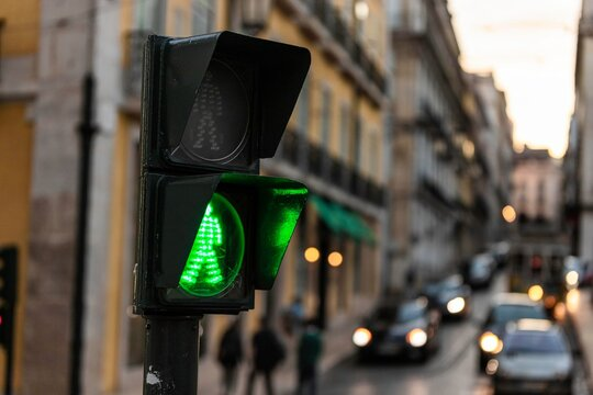 Lisbon, Portugal - 30 October 2020: view of a green traffic lights in the streets of Lisbon city center, Portugal.