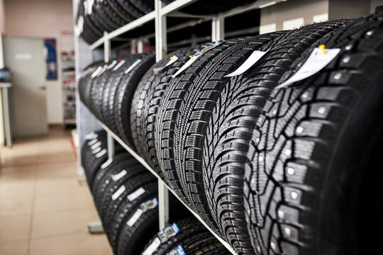 assortment of tires for car in repair garage, replacement of winter and summer tires. seasonal tire replacement concept.