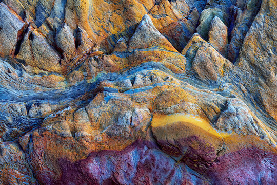 Texture patterns and colors on a cliff of a beach in Asturias