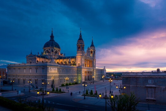Picturesque Almudena Cathedral with ornamental towers on background of sunset sky in Madrid