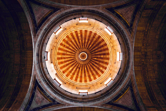 From below of dome and arches of ancient Catholic Church of Santa Engracia built in Baroque style in Lisbon