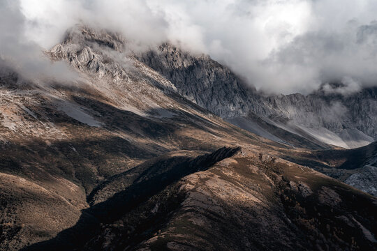 Mist landscape of mountains in autumn with cloudy sky