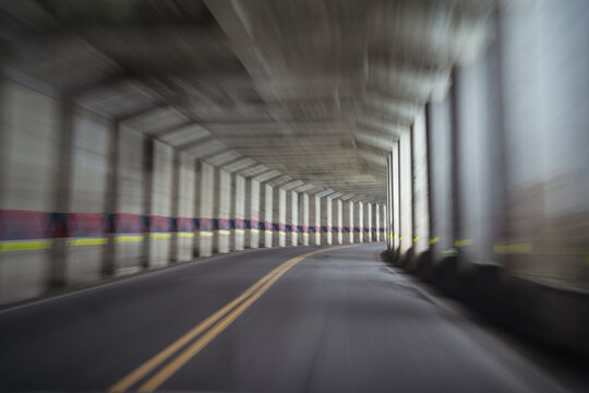 Blurred empty road with columns and concrete ceiling located in Alishan Township in Taiwan