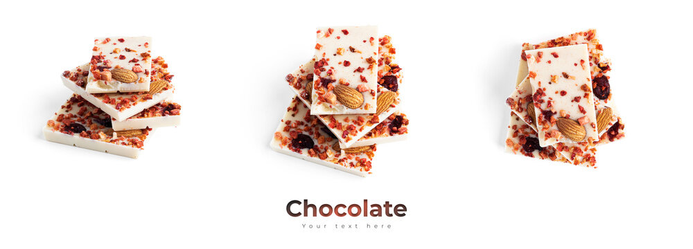 White chocolate with almonds, cranberries and strawberry slices isolated on a white background.