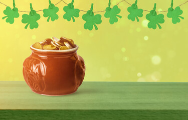 St. Patrick's Day celebration. Pot of gold coins and green clover leaves