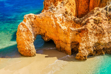 Wall Mural - Landscape with cliff, wild beach and turquoise water in Algarve, Portugal