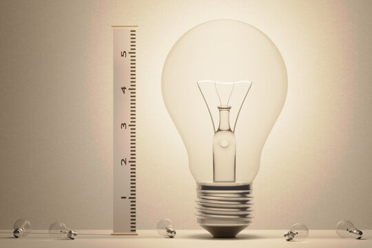 3d illustration. Conceptual image for a fantastic, good idea. Having a great idea. A huge light bulb with other small light bulbs at its feet is measured with a wall height chart.