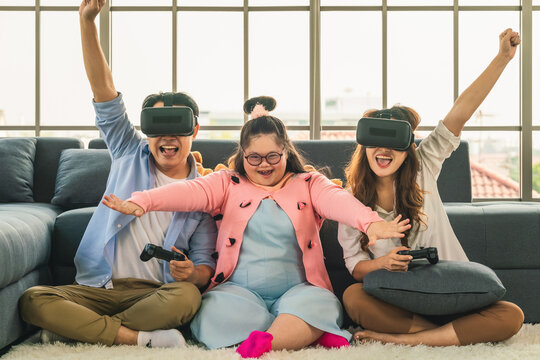 down syndrome teenage girl play 3d vr console game together with family