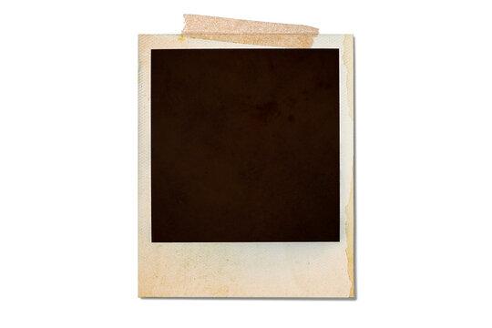 テープで貼られた古いポラロイド写真の背景テクスチャー