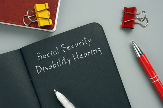 Social Security Disability Hearing sign on the sheet.