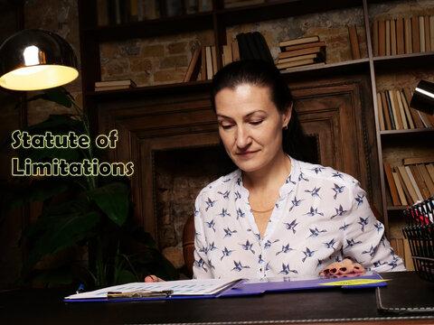 Business concept meaning Statute of Limitations . Closeup portrait of unrecognizable successful Businesswoman wearing formal suit reading documents