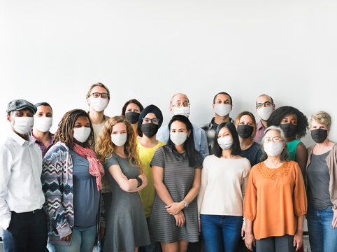 Diverse startup business people with masks in the new normal