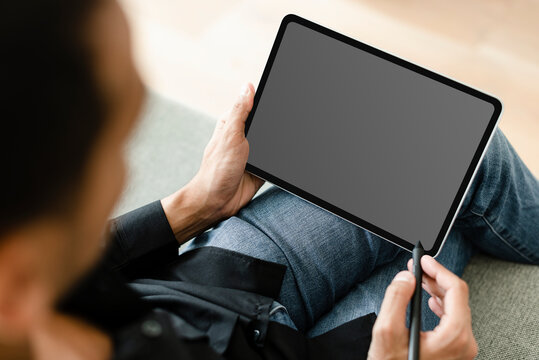 Man using stylus with digital tablet