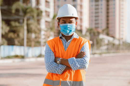 Engineer construction wearing protective mask the spread of Covid 19 diseases during the inspection in construction site. Safety concept