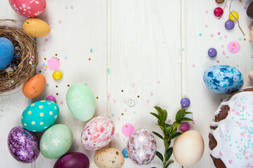 Colorful background with Easter eggs on white wooden board background. Happy Easter concept. Can be...