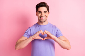 Portrait of satisfied person arms fingers show heart figure look camera isolated on pink color...