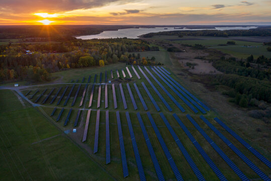 Aerial view of solar farm at sunset