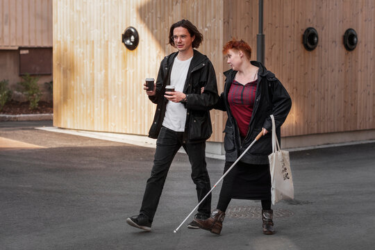 Visually impaired woman walking with male friend